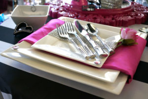 Table setting with square plates and bamboo flatware