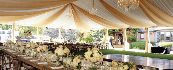 wedding rentals with linens and large outdoor tent