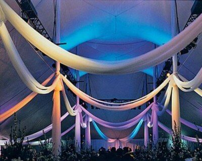 rainbow room with event lighting draping and tenting